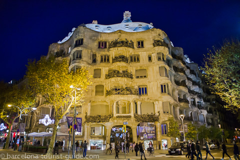 La Pedrera illuminated at night.