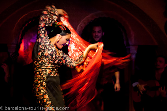 Susana Casas on stage at Tablao Flamenco Cordobés performing with traditional costume and shawl.