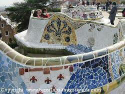 Antoni Gaudí Güell Park - mosaic seating area adorned with multi-coloured tiles