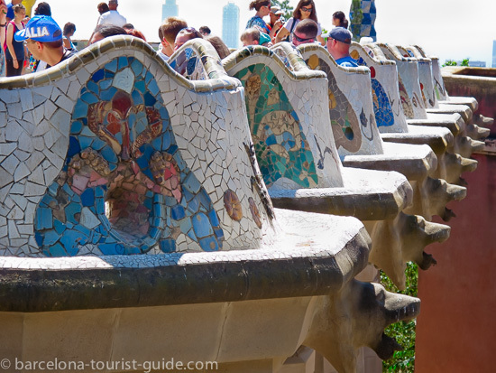 Antoni Gaudí Park Güell - mosaic seating area adorned with multi-coloured tiles