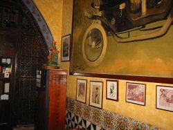 Pictures hanging in the 4 gats Barcelona
