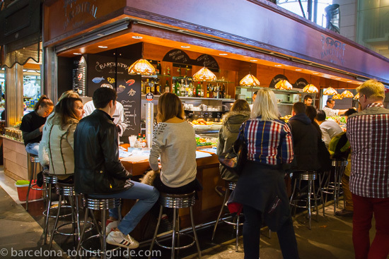 Had enough of shopping? Take a break in a small eatary in Boqueria market